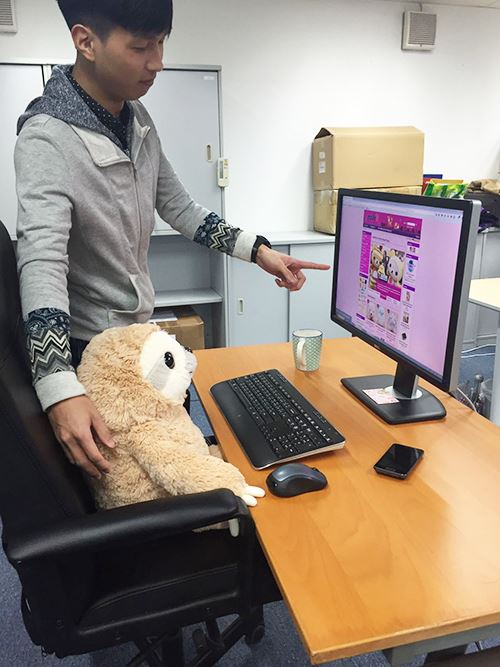 Our sloth colleague, being mentored by our programming wizrd, Mark.