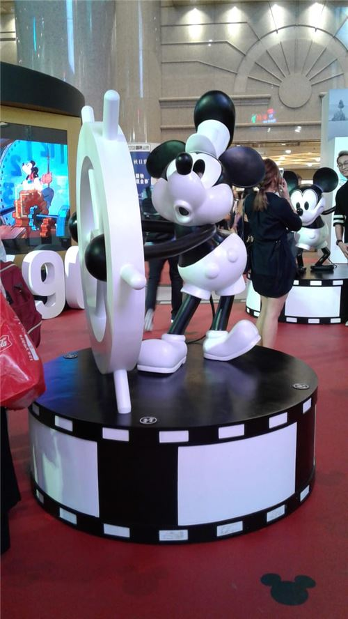 A statue of one of the older Mickey Mouse designs