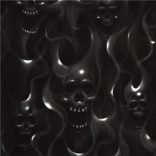 black Alexander Henry fabric with skulls on fire