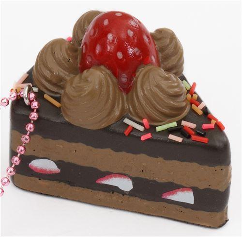 small piece of chocolate cake with sprinkles strawberry squishy cellphone charm