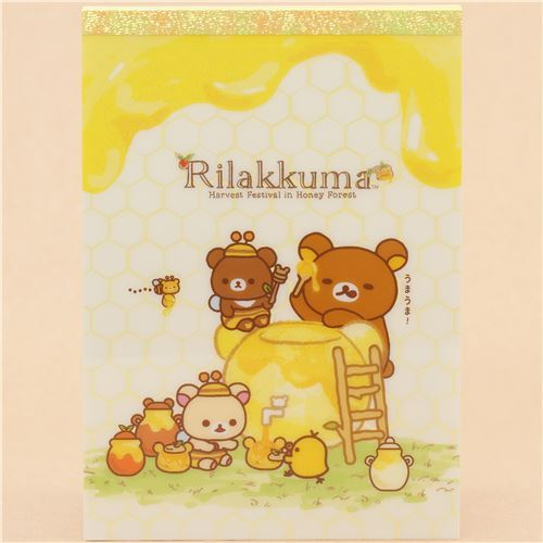 colorful San-X memo pad with Rilakkuma eating honey